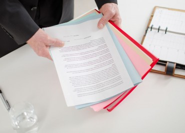 Businessman holding documents